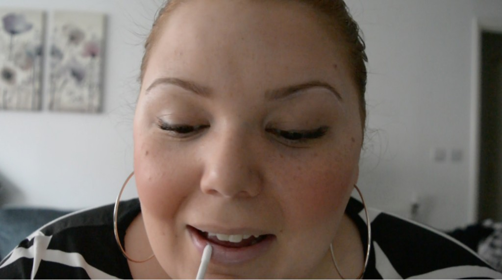 Applying glitter lips from Love Lemonade