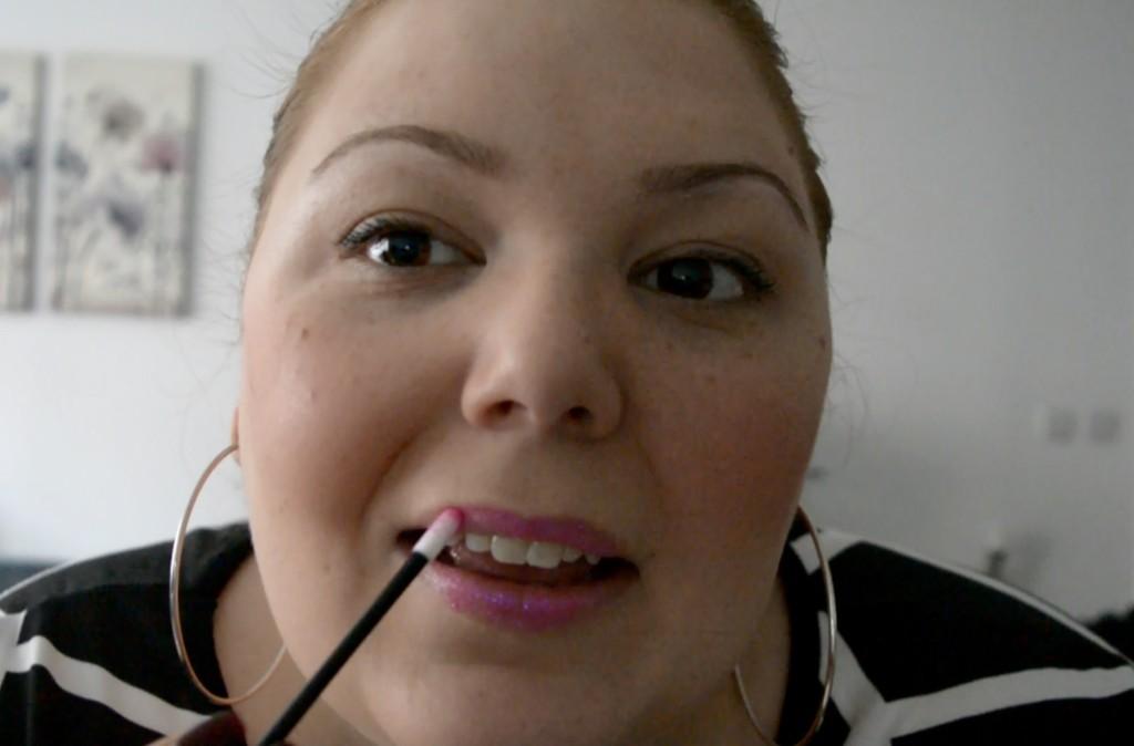 Applying glitter lips from Love Lemonade - blogger review